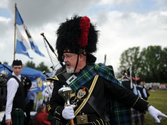 Drum Major Warren Mayes, of Maryville, prepares the pipers and drummers for the opening ceremony and mass band during the Smoky Mountain Scottish Festival & Games at Maryville College on Saturday, May 21, 2016.
