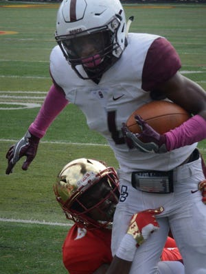 Don Bosco Prep senior wide receiver Wankeith Akin Jr. drags a tackler forward after making a catch against Bergen Catholic earlier this year.