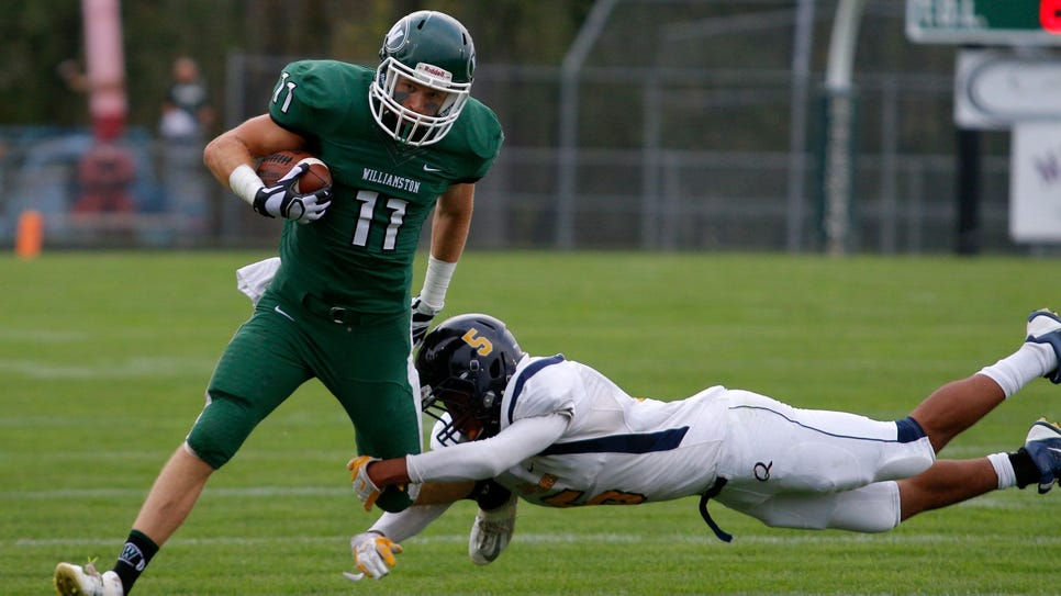 Williamston's Montana Reagan (11) tries to elude a