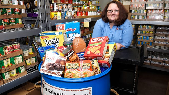 Shannon Smithers, special events and volunteer coordinator, is planning Thanksgiving dinner for 150 people and also oversees the Red Kettle Campaign. She was photographed Friday, Nov. 20 at The Salvation Army.