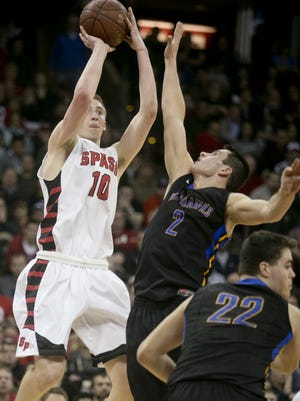 Sam Hauser, lett, is one of four returning starters for a SPASH boys team that has won 27 straight Wisconsin Valley Conference boys basketball games.