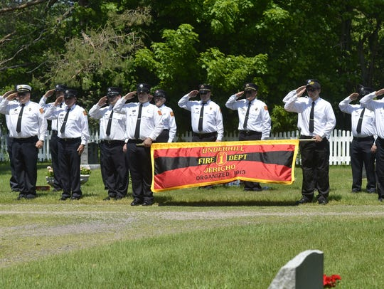 Members of the Underhill-Jericho Fire Department stand