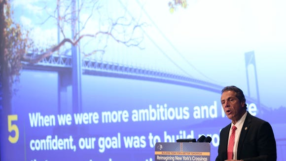 New York Governor Andrew Cuomo speaks about infrastructure projects while an image of a bridge is projected behind him in New York, Wednesday, Oct. 5, 2016.