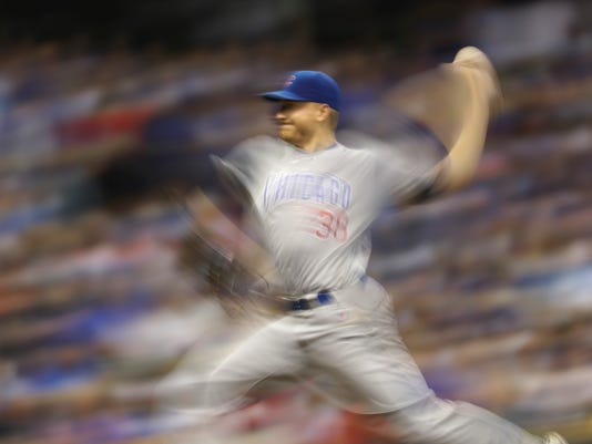 Chicago Cubs starting pitcher Mike Montgomery throws during the fourth inning of a baseball game against the Milwaukee Brewers Wednesday, Sept. 7, 2016, in Milwaukee. (AP Photo/Morry Gash)