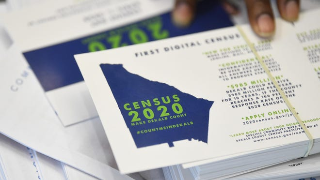 FILE - In this Aug. 13, 2019, file photo, a worker gets ready to pass out instructions on how to fill out the 2020 census during a town hall meeting in Lithonia, Ga. Although the 2020 census kicked off in rural villages of Alaska in January, the rest of the nation gets to start participating in the once-a-decade head count in the coming days. (AP Photo/John Amis, File)