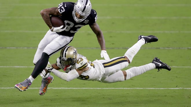 Raiders tight end Darren Waller tries to elude the tackle of Saints cornerback Marshon Lattimore during Monday's game in Las Vegas.  In two games this season, Waller has 18 receptions for 150 yards.