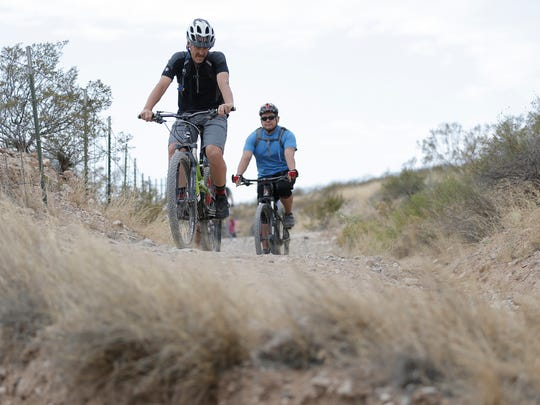 Paul Hanson of the Texas Parks and Wildlife Department leads a beginner mountain bike ride Saturday through the Franklin Mountains in Northeast El Paso.
