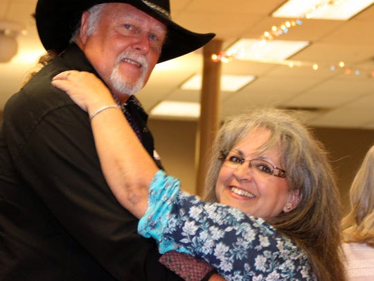Larry and Mayra Srader two-stepped the night away during