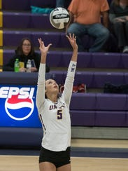 Unioto's Madi Eberst sets during a Division II sectional