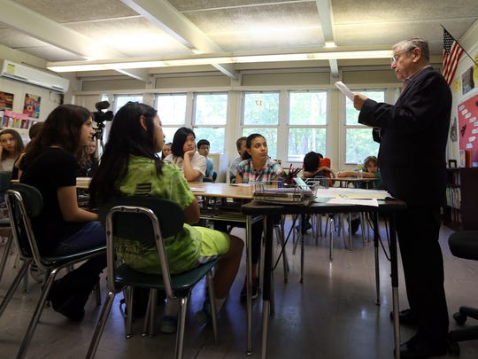 Arthur Bressler of Somerset speaks about his time working at the Port Authority on 9/11/01 during Montville's 'Living Lessons' Voices, Visions and Values program where Holocaust, 9/11, Newtown survivors and more will share their stories at Lazar R. Middle School. May 18, 2017, Montville, NJ