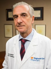 Regional One Health April 27, 2018 - Dr. Giancarlo Mari, professor and chair of the department of obstetrics and gynecology at the University of Tennessee Health Science Center and Chief of OB/Gyn Services at Regional One Health, poses for a portrait at Regional One Health.