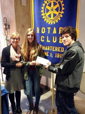 Newfield High School social worker Jamie McCaffrey, left, joins members of the school's Sources of Strength Club Savanna Scott, center, and Devon Poludniak in accepting an award at the Ithaca Rotary's Community Grants Program Award Ceremony.