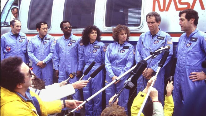 """Space shuttle Challenger crew. Francis """"Dick"""" Scobee, Michael Smith, Judy Resnik, Christa McAuliffe, Ron McNair, Ellison Onizuka, Gregory Jarvis. FLORIDA TODAY file photo --1/86---Space shuttle Challenger crew meeting the media at the launch pad. Francis """"Dick"""" Scobee; Michael Smith; Judy Resnik; Christa McAuliffe; Ron McNair; Ellison Onizuka; Gregory Jarvis"""