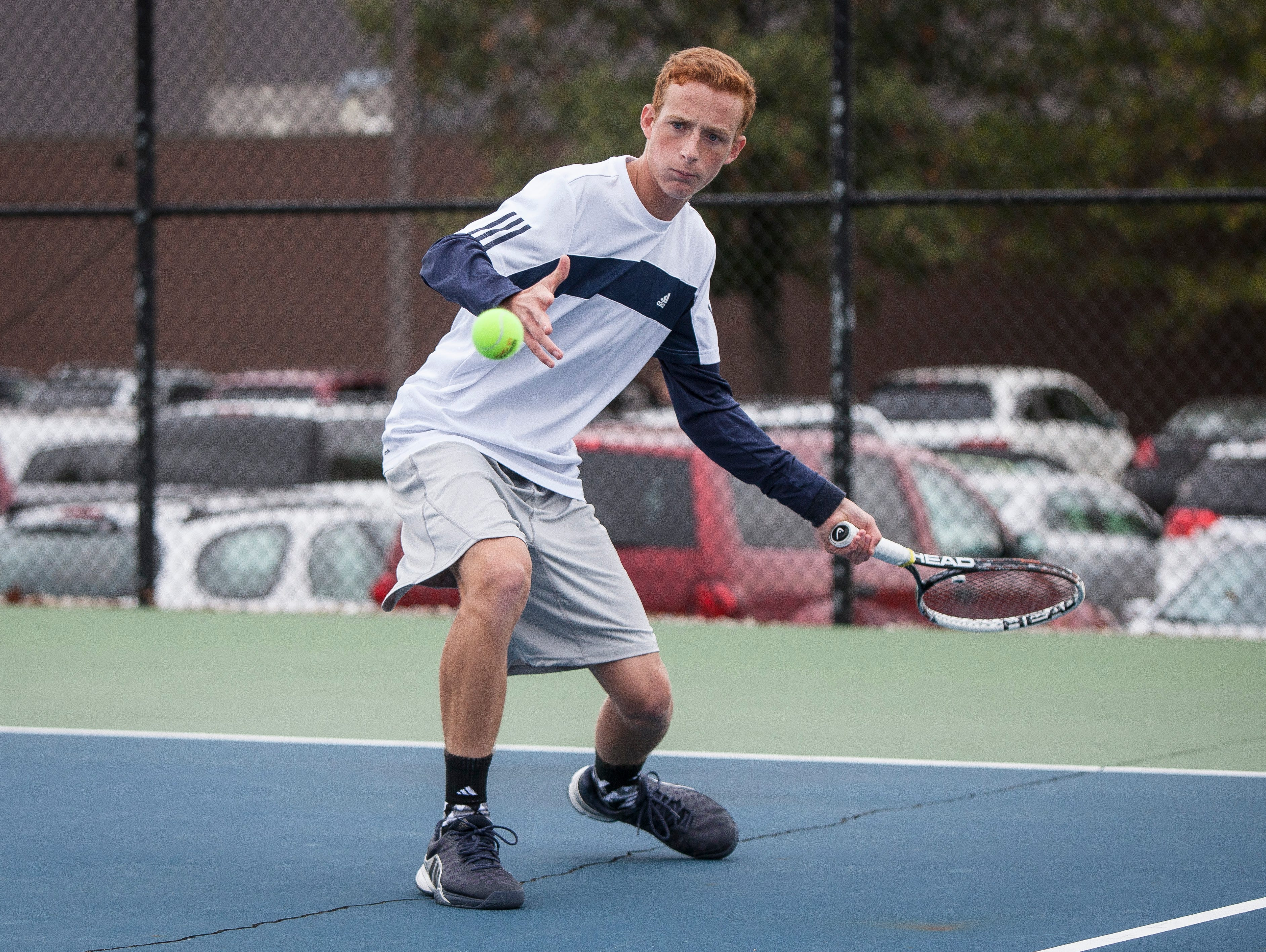 Delta's Jason Wegener is locked in a volley with his Yorktown opponent Thursday evening at the tennis sectional held at Delta High School. Delta won the sectional 4-1.