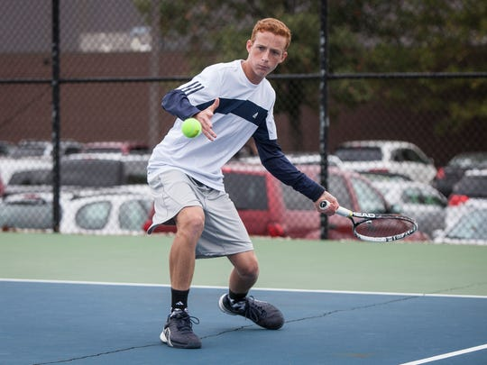 Delta's Jason Wegener is locked in a volley with his
