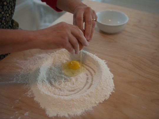Jolynn Deloach  mixes the eggs, flour and dough during handmade pasta making demonstration at her home in Merchantville.