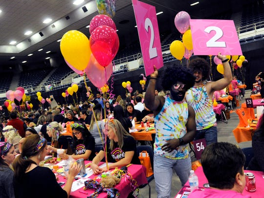 More than 1,500 people gathered to play bunco Tuesday, evening, Oct. 10, 2017, at the Taylor County Coliseum. The 15th annual tournament raised money for the Hendrick Health System's Hope Fund, which pays the cost of a mammogram for women who cannot afford it. Disco was the theme for the evening and a costume contest was held later in the evening.