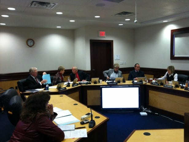 Members of the Iowa Transportation Commission prepare for their meeting Tuesday afternoon (Jason Noble/The Register).