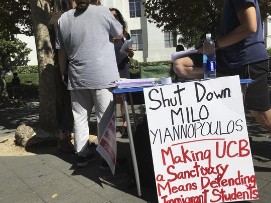 """In this Sept. 21, 2017 photo, a group has put up flyers and a booth on Sproul Plaza calling for protesters to """"Shut Down Milo Yiannopoulos,"""" at the University of California, Berkeley campus in Berkeley, Calif. Right-wing showman Milo Yiannopoulos is holding a """"Free Speech Week"""" at the University of California, Berkeley with a planned lineup including conservative firebrands Steve Bannon and Ann Coulter."""