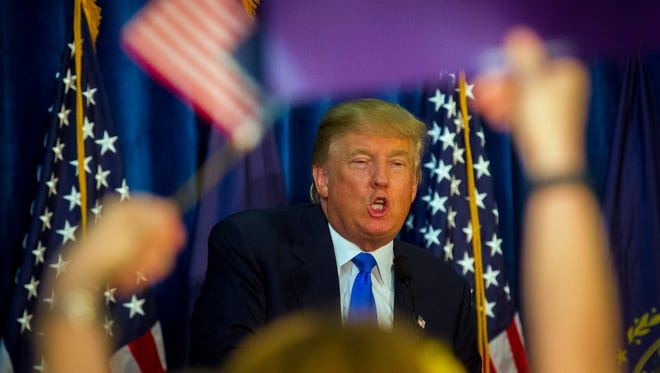 Republican presidential candidate Donald Trump attends a rally at Manchester Community College in Manchester, N.H., on June 17, 2015.