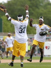 Sam Shields and Damarious Randall celebrate after Randall made a catch against the offense during the Jordy Nelson Charity Softball Game Sunday in Grand Chute.