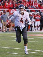 Washington State quarterback Luke Falk (4) carries