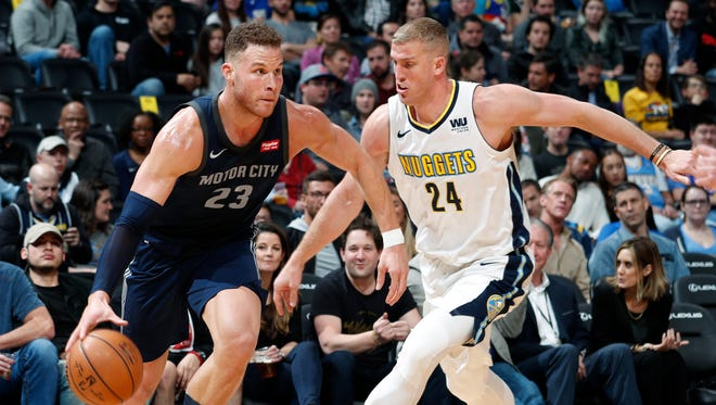 Pistons forward Blake Griffin drives past Nuggets center Mason Plumlee in the first half Thursday in Denver.