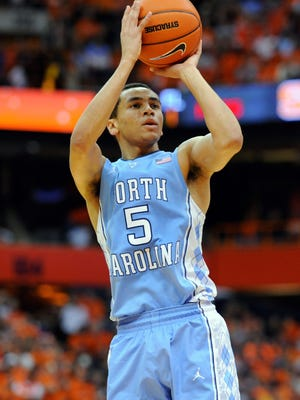 North Carolina Tar Heels guard Marcus Paige (5) takes a shot against the Syracuse Orange during the second half at the Carrier Dome. Syracuse defeated North Carolina 57-45.