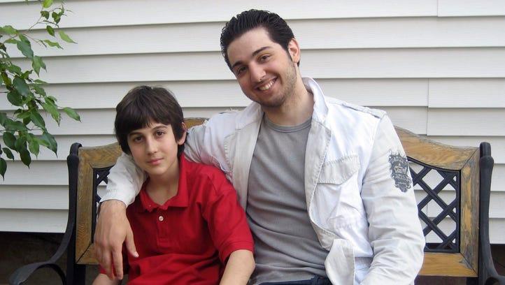Brothers Dzhokhar, left, and Tamerlan Tsarnaev sit