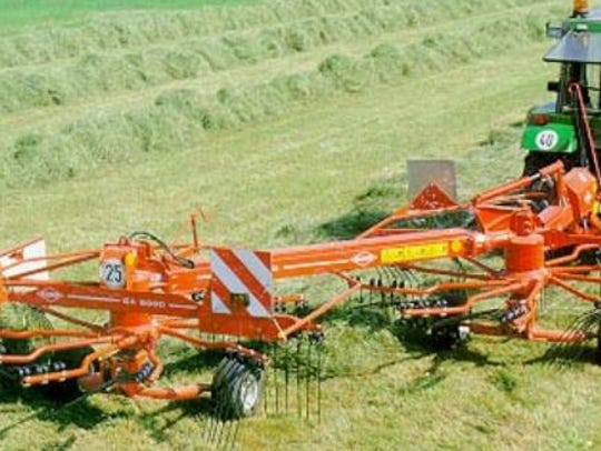 A rotary rake helps to merge swaths into a windrow.