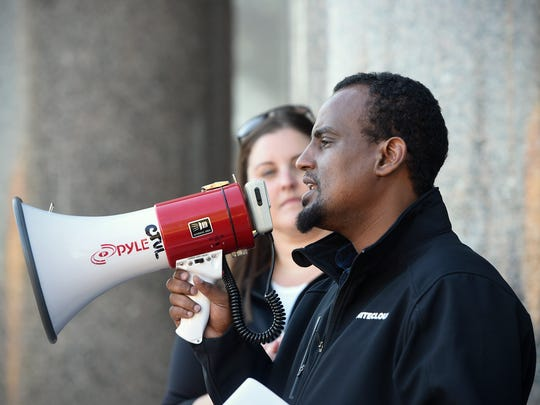 UniteCloud co-founder Haji Yusuf speaks during a rally