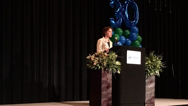 Chief executive officer of the Greater Muncie Habitat for Humanity, Lindsey Arthur, talks about the organizations new focus on one neighborhood during the organization's annual breakfast April 28.