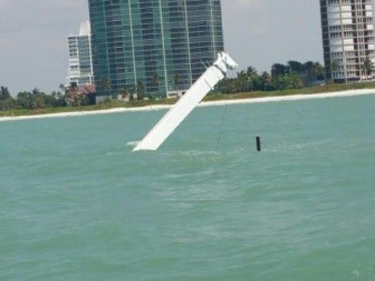 A dock-building barge sinks near Wiggins Beach, Fla.,