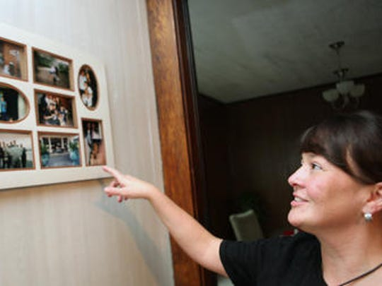 In September 2011, Michelle (Bright) Hornback talks about some of the family pictures on her wall that include her brother, Gary Bright, who died in the World Trade Center on September 11, 2001.