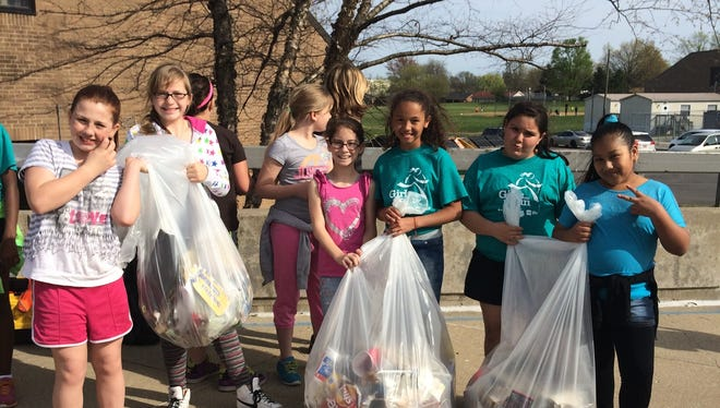 "Picking up trash with the Collins Elementary ""Girls on the Run"" squad are, from left, Jessie Newcomb, Yazmin Loveless, Payton Turgeon, Arianna Hutchinson, Laura Ledezma and Stephanie Calderon."