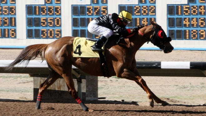 Cassy Sue, ridden by Alfredo Juarez Jr., for trainer Justin Evans, opens up for a clear victory in Monday's $34,100 Budweiser Handicap at SunRay Park and Casino in Farmington.