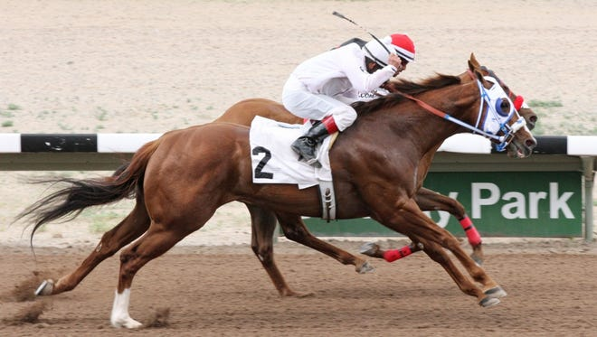 Clear Winn (2), with Porfirio Cano aboard, outnods Stick Shift Sc to his inside and wins the narrowest of photo finishes on Sunday at SunRay Park and Casino in Farmington.