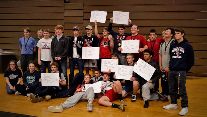 Shown are the West-Oak High School Wrestling Team Region 1AAA Champions. In the  bottom row from left to right are Abby Brewer, Lauren Crowley, Jared Smith, Justin Smith, Damien White and Thomas Rowland; kneeling in center are Matthew Williams, Ben Martin and Jordan Lee; and standing are Eli Thaxton, Jordan Brown, Ryan Rholetter, Ethan Powell, Ryan Butts, Lake Alexander, Ian James, Tate Capps, Cameron Hamby, Gavin James, Clayton James, Garrett Dickson, Tyler James and Zach Elliott.