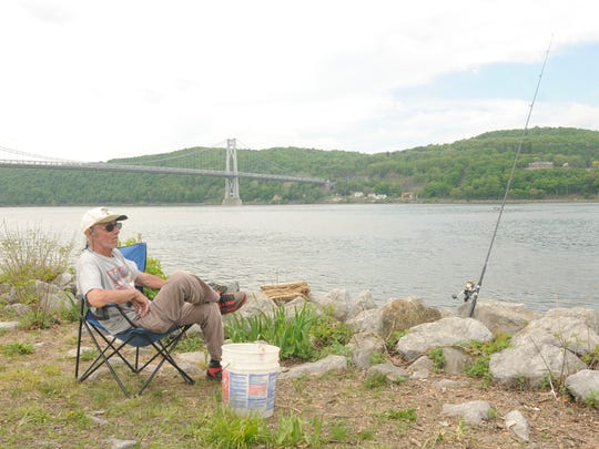 Frank Bass of Kent Cliffs sits on the banks of the Hudson River in Victor C. Waryas Park in this file photo.