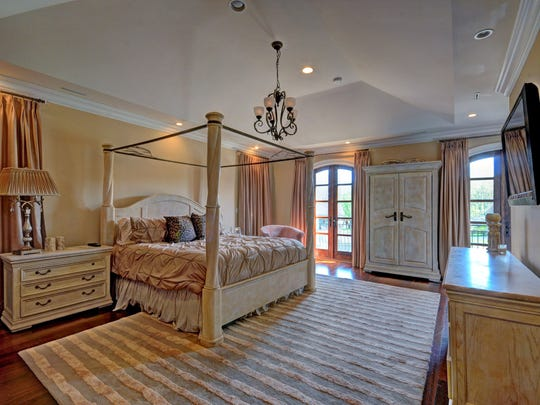 Inside the master suite, there is a large sitting room with a fireplace.