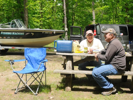 Frank Kurant Jr., right, and Don Chioffi, left, both of Rutland, Vermont, sit in a picnic area of Mills-Norrie State Park after taking a break from fishing for stripers on the Hudson River.