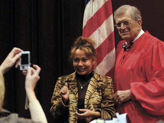 One of 27 newly sworn-in U.S. citizens poses for a