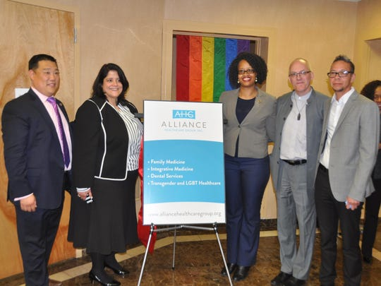 Dana Delgardo (far right) at the opening of Alliance Community Health in Jersey City.