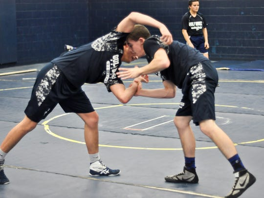 Gulf Breeze wrestler Blake Doerr, left, gets in a final