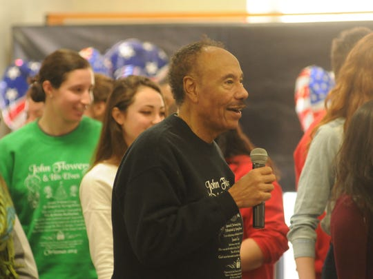 John Flowers, community organizer and radio show host, gets the volunteers up and dancing toward the end of the event.