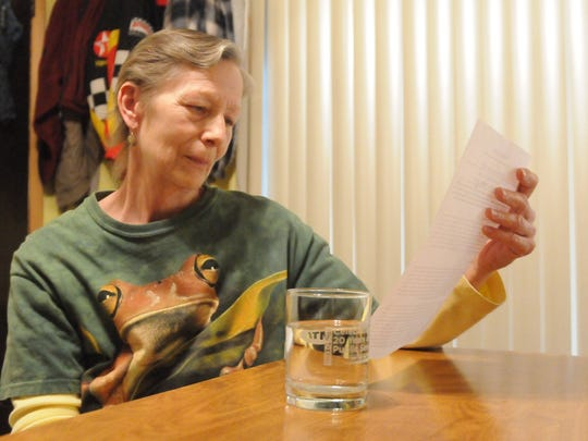 Jan Weidler of Hyde Park, who lives in the Greenbush water district, looks at a copy of the water notice she received in December about the changing water standards.