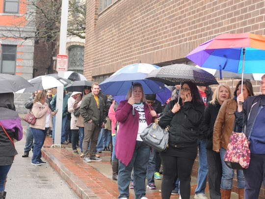 """Even with the rain, people waited in line for contestant registration on """"The Price Is Right Live,"""" held at the Mid-Hudson Civic Center in the City of Poughkeepsie."""