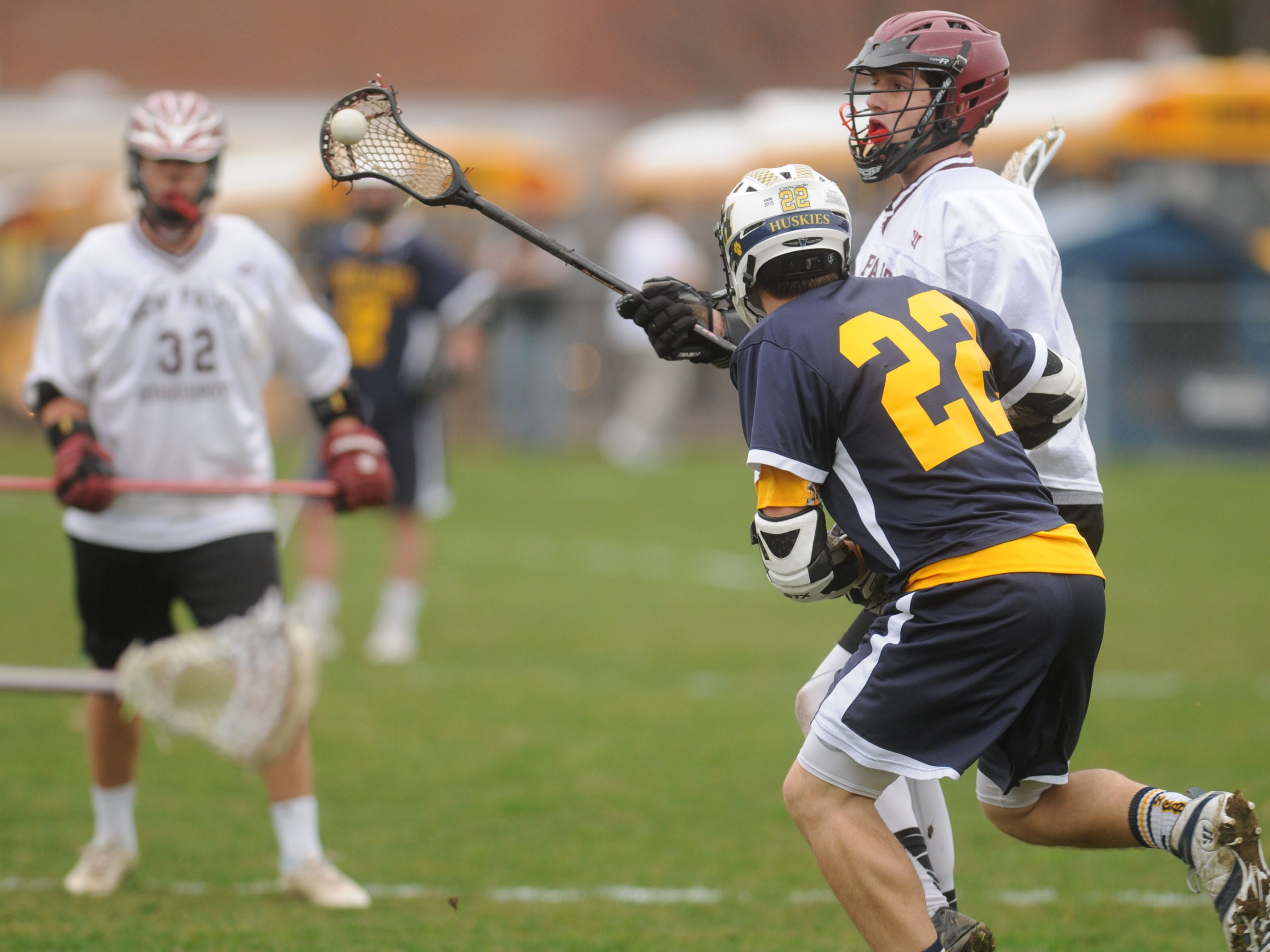 New Paltz's Avery Sells, top, passes the ball to a teammate while Highland's Jason Chlus, bottom, defends.