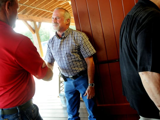Donald Strickland greets people at the door at Open Range Fellowship, a cowboy church in Greenwood.  Henrietta Wildsmith/The Times