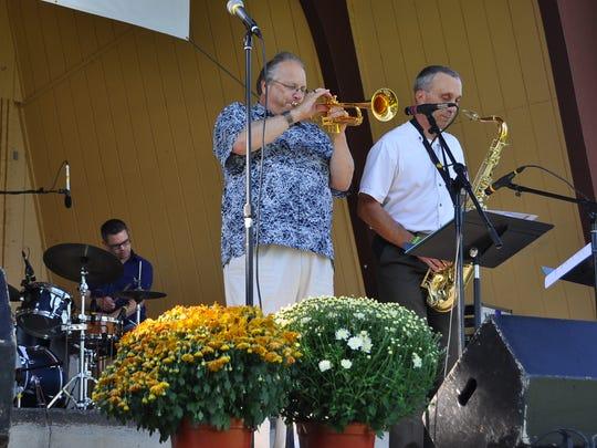 Bob Kase, left, and John Greiner perform during the 2013 Riverfront Jazz Festival at Pfiffner Pioneer Park.
